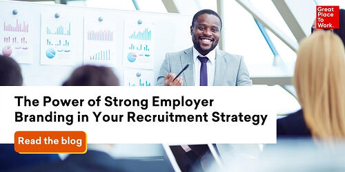 man-in-suit-at-whiteboard-employer-branding-data-for-recruitment-strategy
